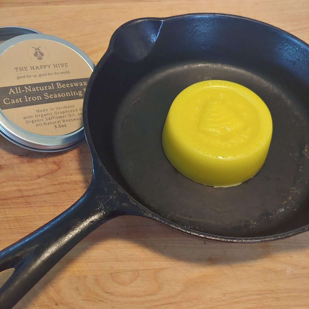 cast iron seasoning bar in cast iron pan